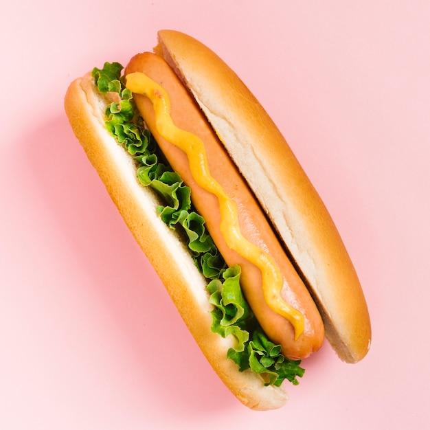 Flat lay hotdog with mustard and salad Free Photo