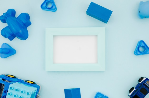 Flat lay kids toys with mock-up frame Free Photo