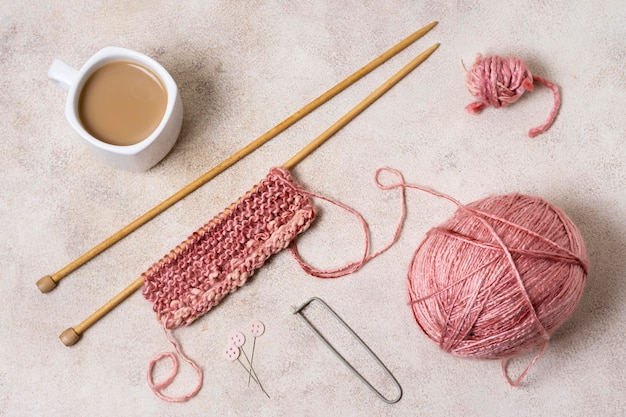 flat lay knitting tools with coffee 23 2148643271