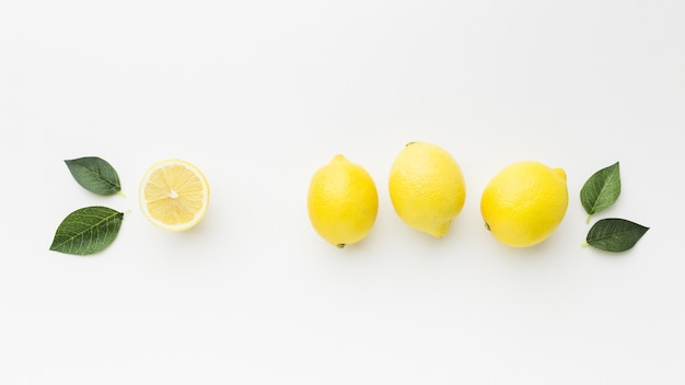 Flat lay of lemon with leaves concept Free Photo
