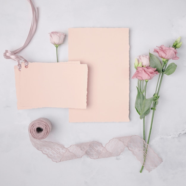 Flat lay lovely arrangement with wedding invitations and flowers Free Photo