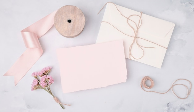 Flat lay lovely arrangement with wedding invitations Free Photo