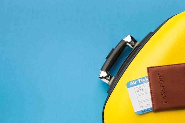 Flat lay of luggage and passport with copy space Free Photo