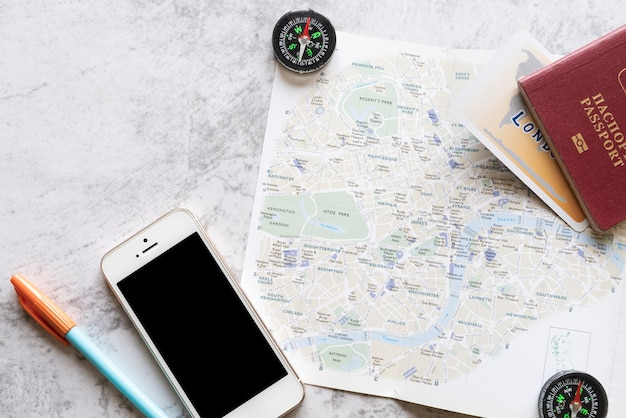 Flat lay map with travel accessories Free Photo