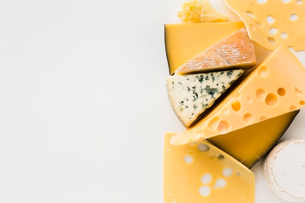 Flat lay mix of gourmet cheese with copy space Free Photo