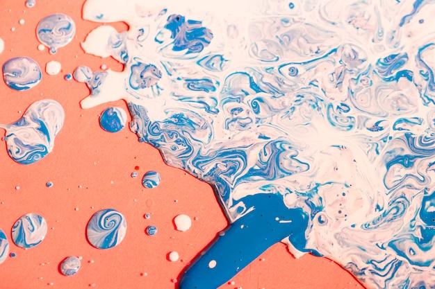 Flat lay mixed paint on orange background Free Photo