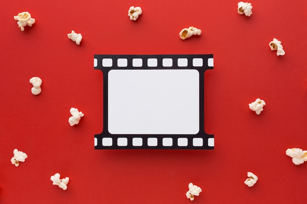 Flat lay movie elements on red background Premium Photo