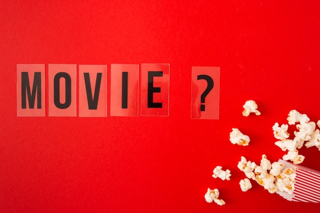 Flat lay movie lettering on red background Free Photo