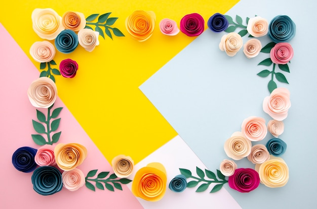 Flat lay multicolored background with flowers frame Free Photo
