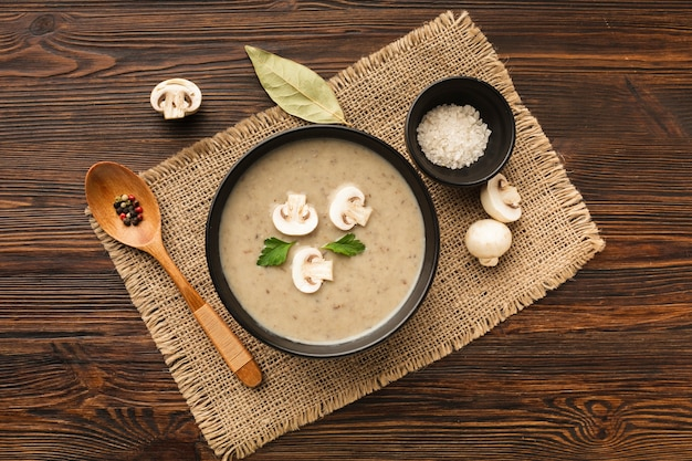 Flat lay mushrooms bisque and spoon Free Photo