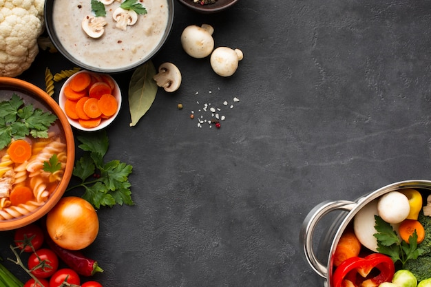 Flat lay musroom bisque vegetable soup with fusilli and vegetables in pan with copy spacecopy space Free Photo