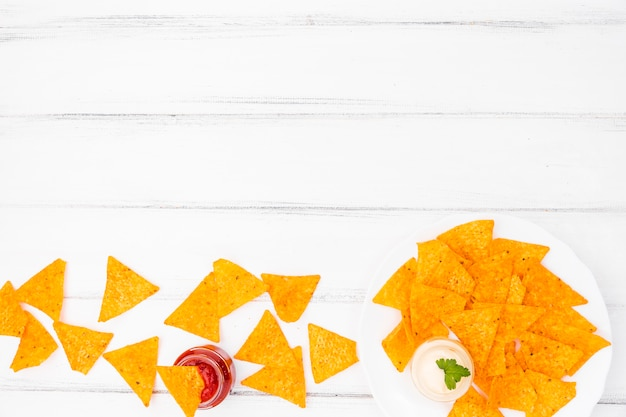 Flat lay of nachos with copyspace Free Photo