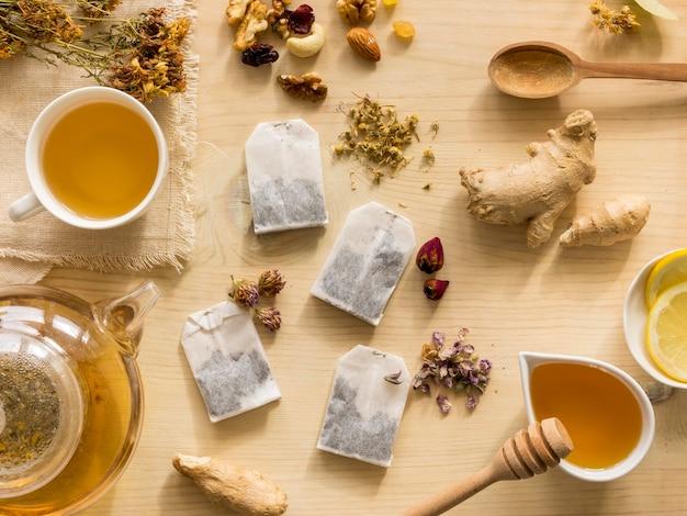 Flat lay of natural medicinal herbs with tea Free Photo