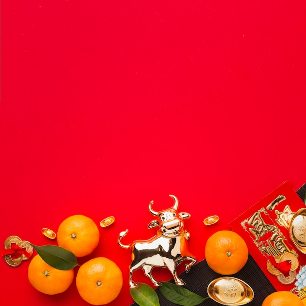 Flat lay new year chinese 2021 oranges and golden ox Free Photo