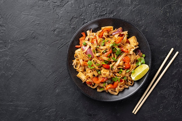 Flat lay noodles with vegetables and chicken with copy space Premium Photo