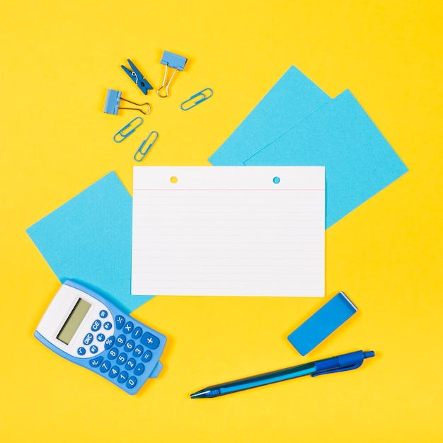 Flat lay of note mock-up with yellow background Free Photo