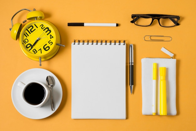 Flat lay notebook and coffee cup Free Photo