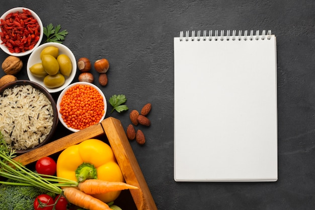 Flat lay of notebook mock-up and vegetables Free Photo