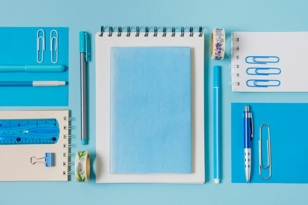 Flat lay notebooks and pens arrangement Free Photo