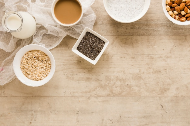 Flat lay oats seeds and coffee with copy space Free Photo