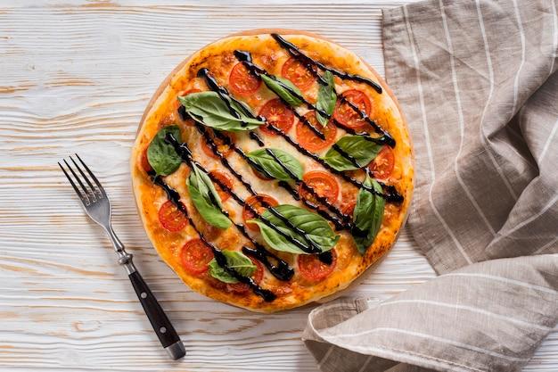 おいしいピザのコンセプトのフラットレイアウト 無料写真