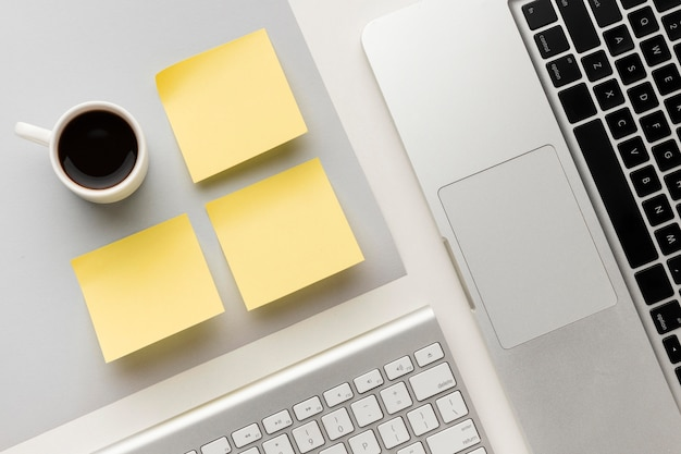 Flat lay office desk composition with empty post its Free Photo