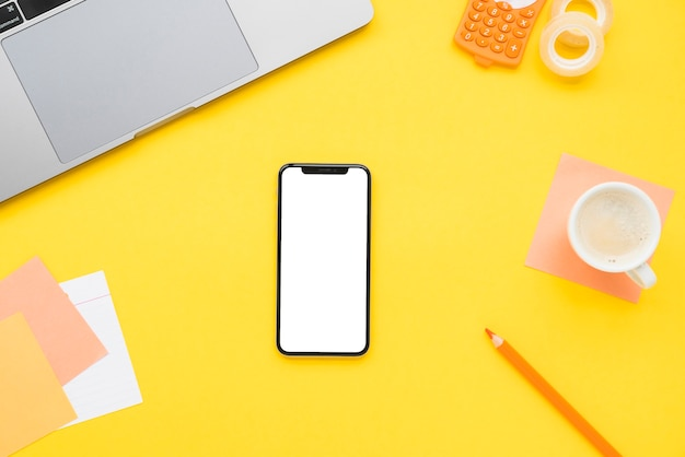 Flat lay of office desk with phone Free Photo