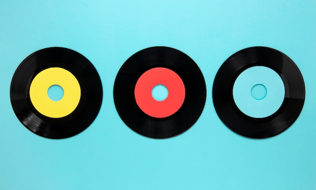 Flat lay old disc records on blue background Free Photo
