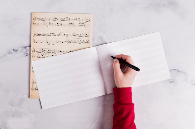 Flat lay of open book for music notes Free Photo