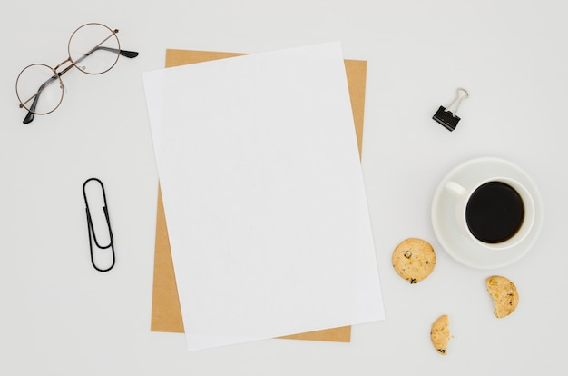 Flat lay paper mockup on workspace Free Photo