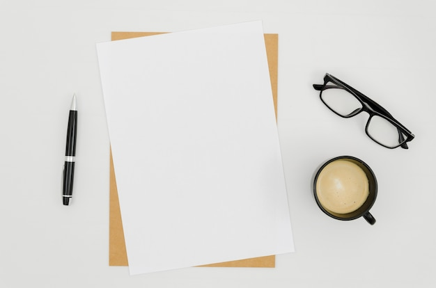 Flat lay paper mockup on workspace Free Photo