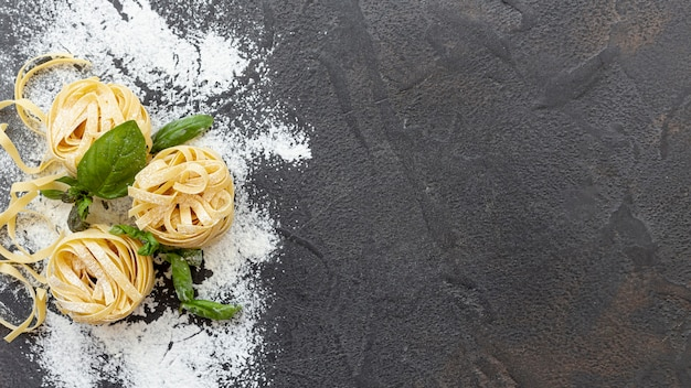 Flat lay of pasta arrangement with copy space Free Photo