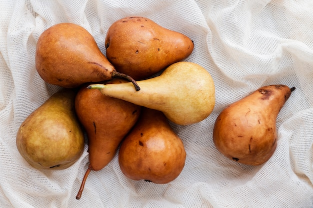 Flat lay pears on textile Free Photo