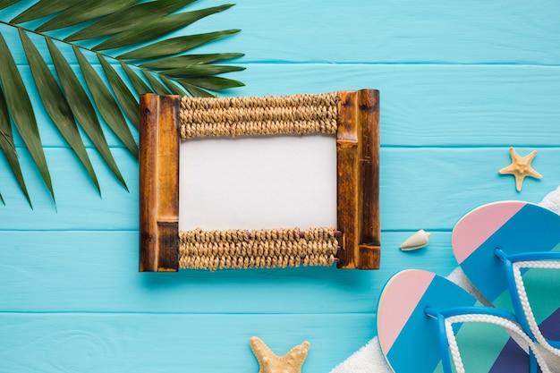 Flat lay photo frame with palm leaf Free Photo