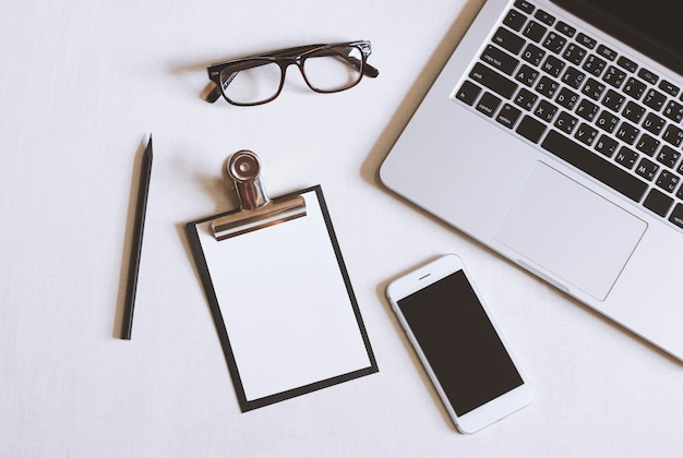 Writing Desk Background ~ Flat lay photo of office desk with laptop smartphone