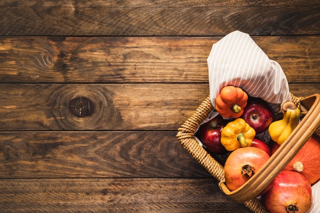 Flat lay picnic basket with autumn food Free Photo