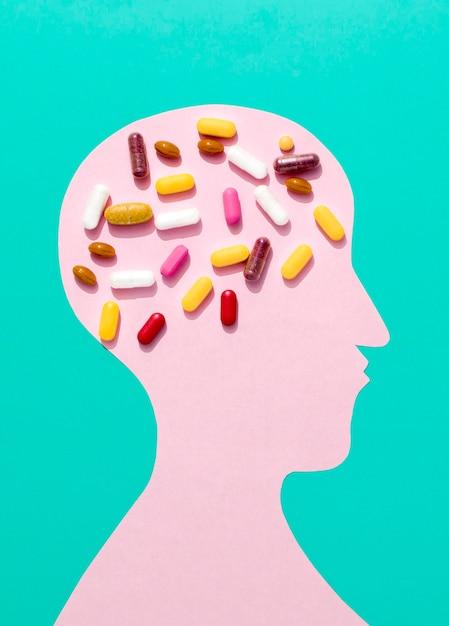 Flat lay of pills on brain of human shape Free Photo