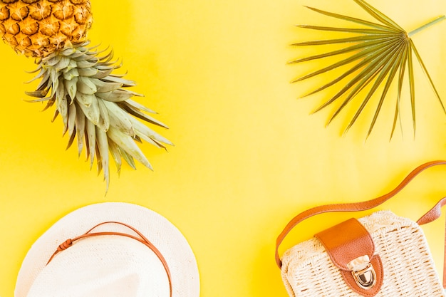 Flat lay of pineapple with summer accessories Free Photo