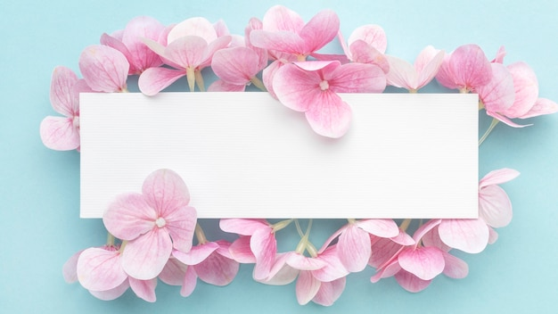 Flat lay pink hydrangea flowers with blank rectangle Premium Photo