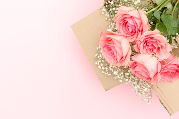 Flat lay of pink roses bouquet Free Photo