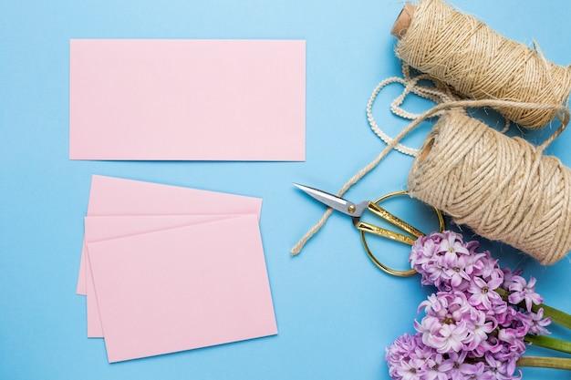 Flat lay pink wedding invitations Free Photo