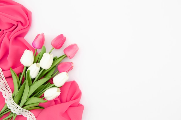 Flat lay of pink and white tulips Free Photo