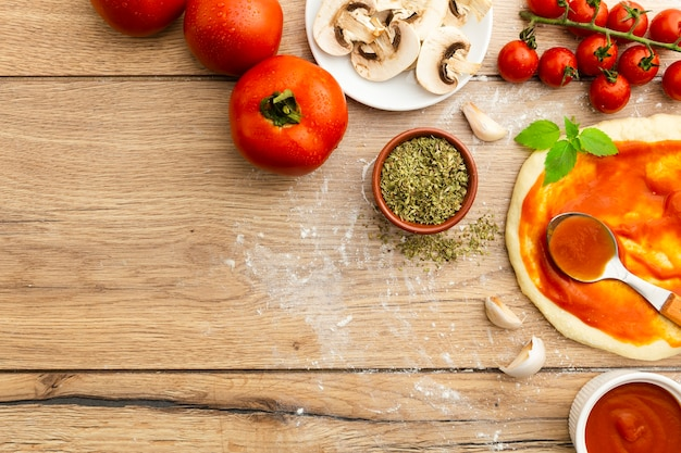 Flat lay of pizza ingredients Free Photo