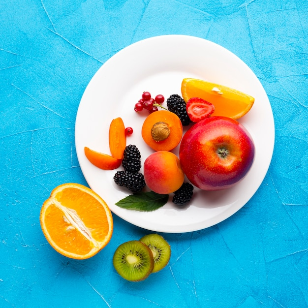 Flat-lay plate of fresh berries and fruits Free Photo