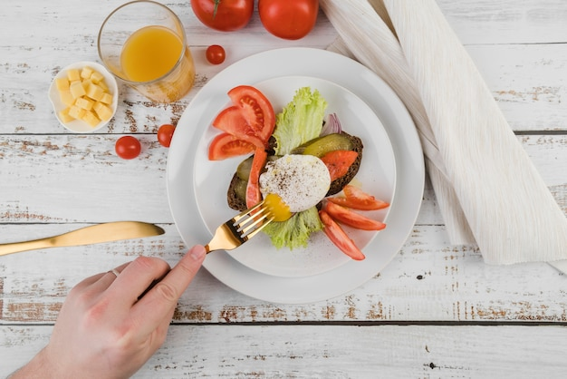 Flat lay plate with breakfast on table Free Photo