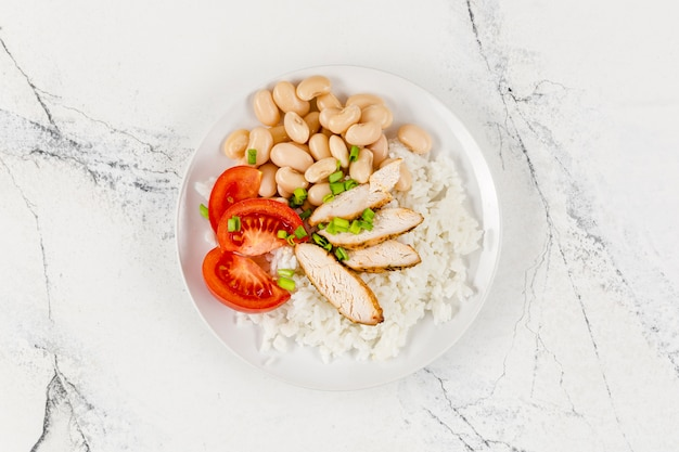 Flat lay of plate with rice and beans Free Photo