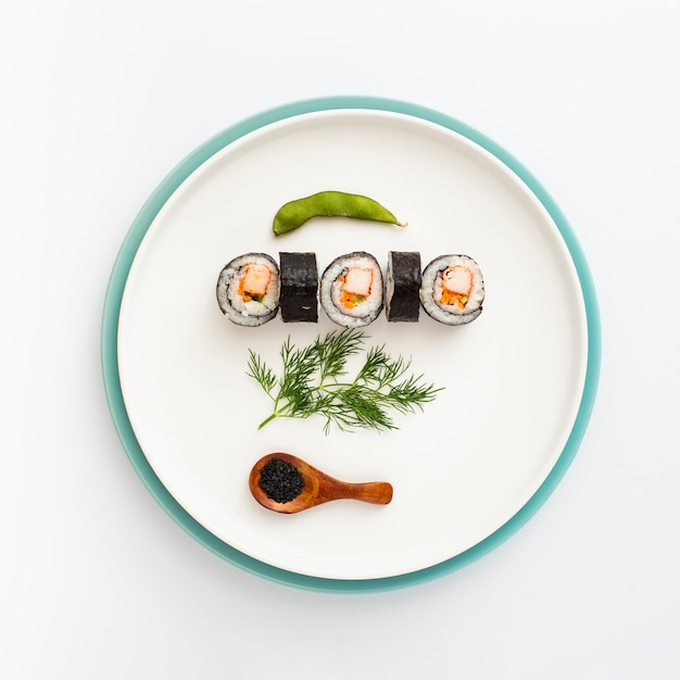 Flat lay plate with sushi Free Photo
