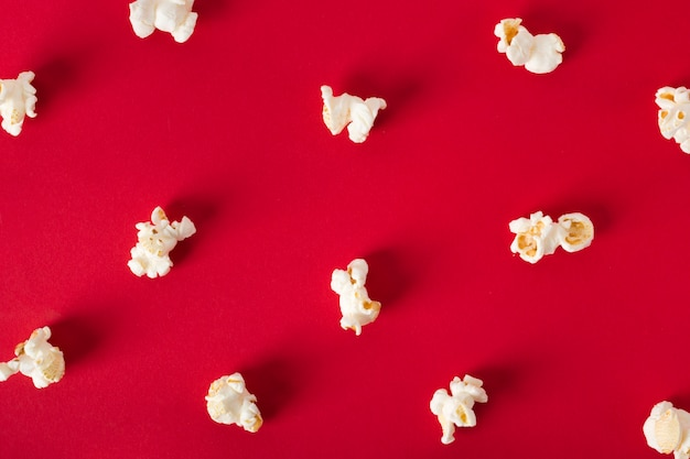 Flat lay popcorn on red background Free Photo