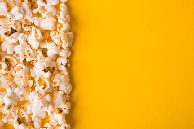 Flat lay popcorn on yellow background with copy space Free Photo