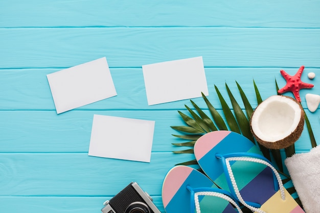 Flat lay postcards with beach accessories Free Photo